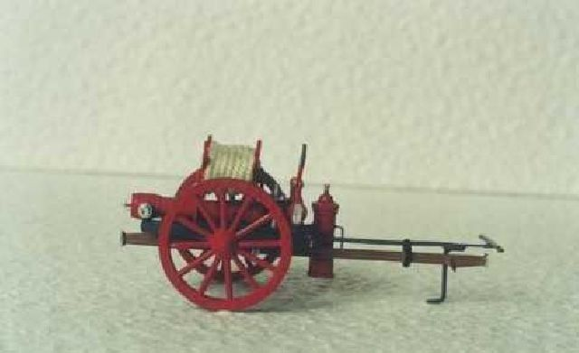 Hand-operated fire cart with original fire equipme